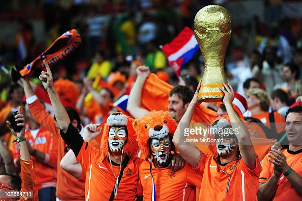 Netherlands fans celebrate victory and progression to the semifinals following the 2010 FIFA World Cup South Africa Quarter Final match between...