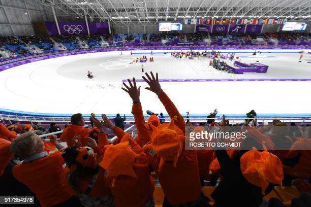 Netherlands' fans react during the women's 1,500m speed skating event at the Pyeongchang 2018 Winter Olympic Games at the Gangneung Oval in Gangneung...