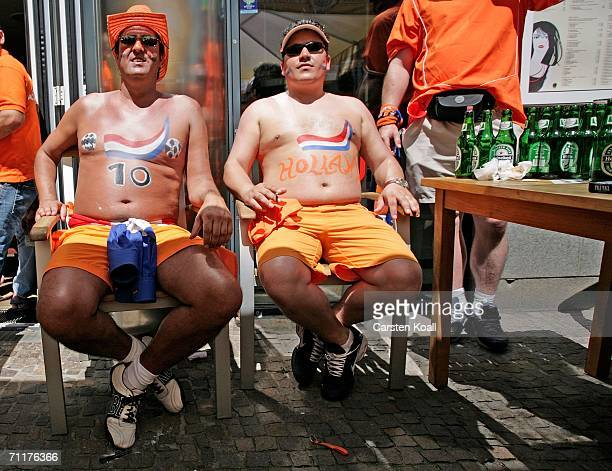 Netherlands fans with painted chests enjoy the Netherland v Croatia Group C match during the 2006 Germany World Cup June 11, 2006 in Leipzig,...