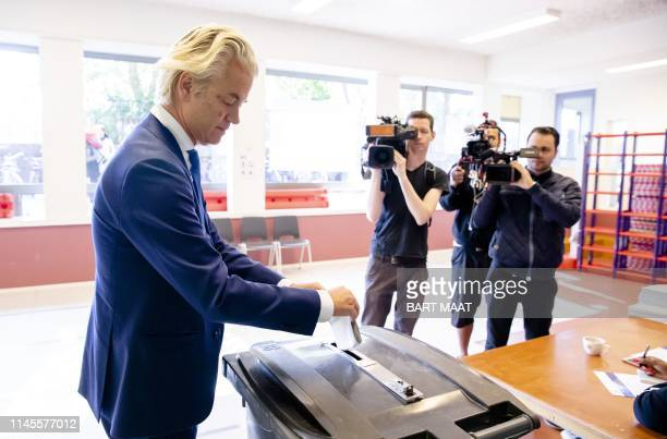 Netherlands' farright 'Partij voor de Vrijheid' party leader Geert Wilders casts his ballot for the European elections at a polling station in The...