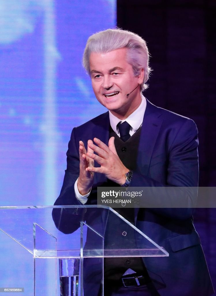 Netherlands' far-right politician Geert Wilders of the PVV party gestures during a debate with Netherlands' prime minister Mark Rutte of the VVD Liberal party on March 13, 2017 in Rotterdam, prior to March 15 Dutch parliamentary elections. /