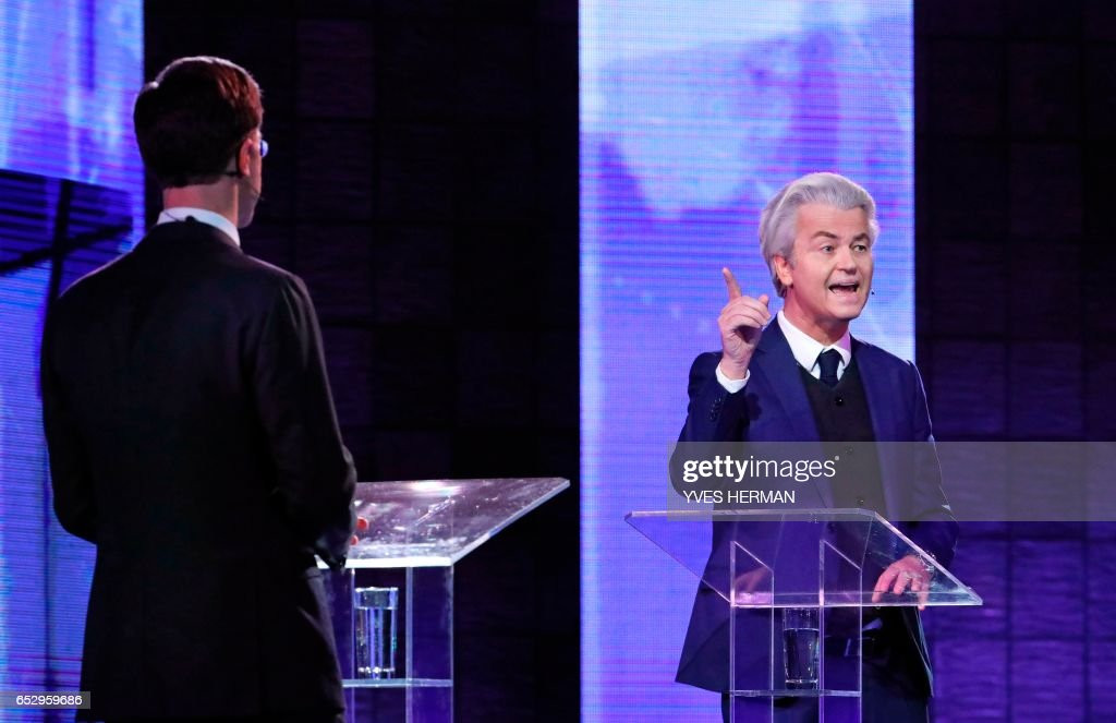 Netherlands' far-right politician Geert Wilders (R) of the PVV party gestures during a debate with Netherlands' prime minister Mark Rutte of the VVD Liberal party on March 13, 2017 in Rotterdam, prior to March 15 Dutch parliamentary elections. /