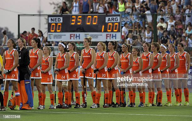 Netherlands' field hockey team sing the national anthem before the Champions Trophy 2012 semifinal field hockey match against Argentina in Rosario...