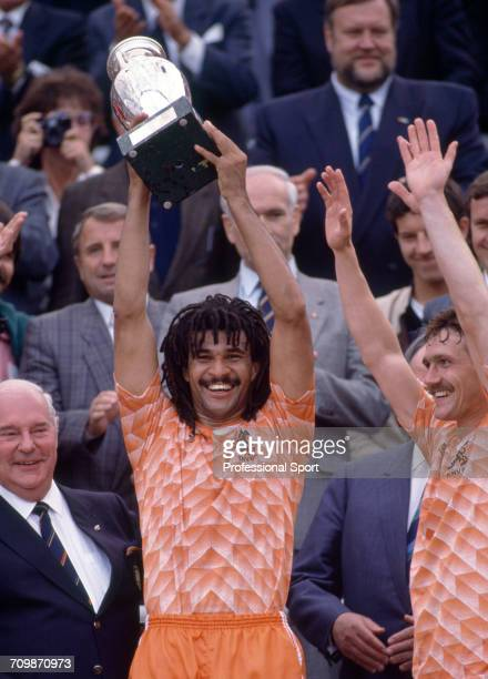 Netherlands football team captain Ruud Gullit raises the UEFA European Championship trophy in the air after Netherlands beat the Soviet Union 2-0 to...