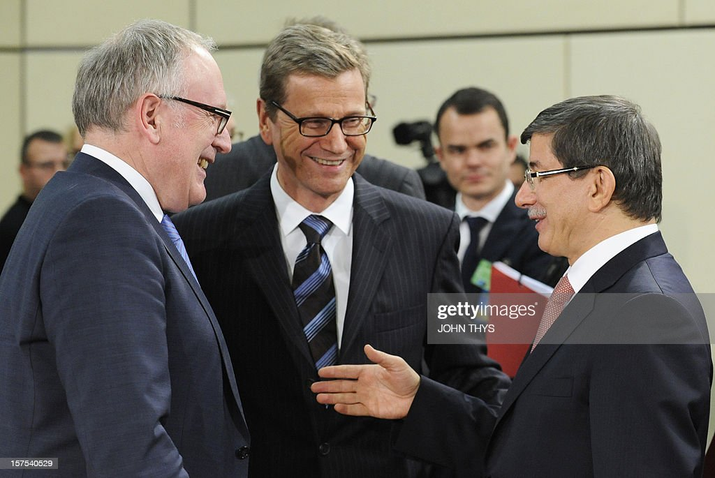 Netherlands' Foreign Minister Frans Timmermans (L) speaks with Germany's Foreign Minister Guido Westerwelle (C) and Turkey's Foreign Minister Ahmet Davutoglu (R) during a meeting of foreign affairs ministers from the 28 North Atlantic Treaty Organization (NATO) member-countries to discuss Syria and Turkey's request for Patriot missiles to be deployed protectively on the Turkish-Syrian border at the NATO Headquarters in Brussels, on December 4, 2012.
