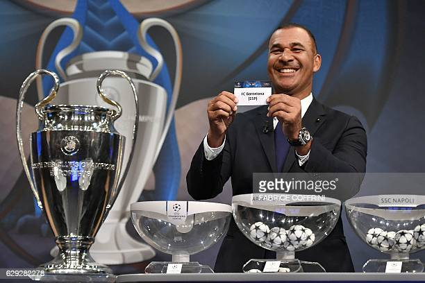 Netherlands' former striker Ruud Gullit shows the name of Barcelona during the draw for the round of 16 of the UEFA Champions League football...