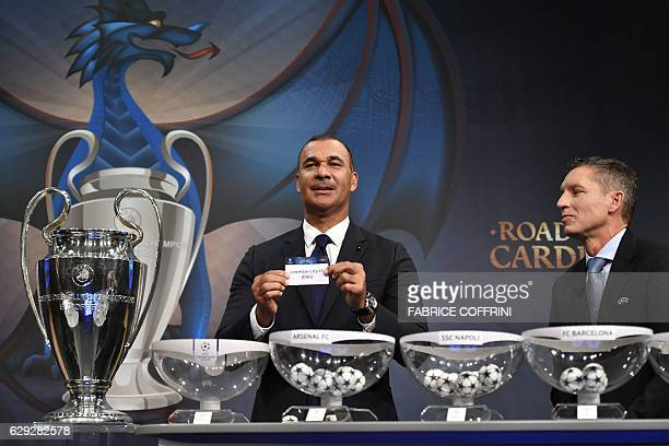 Netherlands' former striker Ruud Gullit shows the name of Leicester City next to UEFA's head of club competitions Michael Heselschwerdt during the...