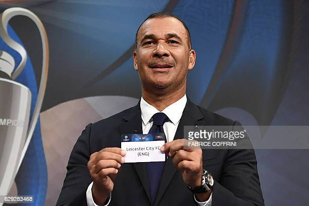 Netherlands' former striker Ruud Gullit shows the name of Leicester City during the draw for the round of 16 of the UEFA Champions League football...