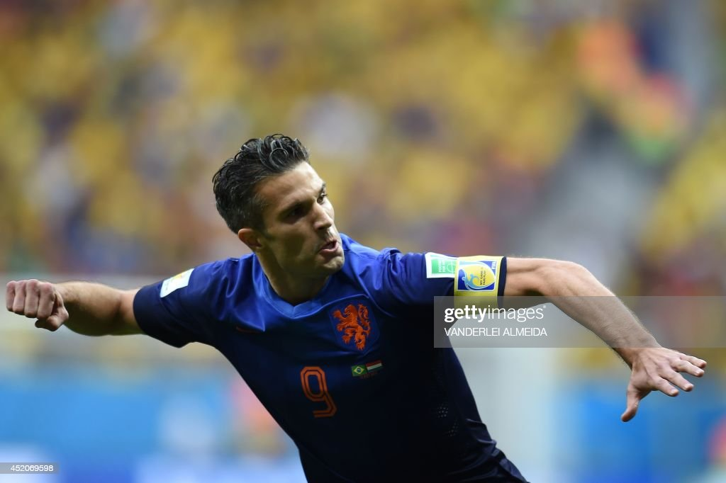 Netherlands' forward and captain Robin van Persie celebrates after scoring a goal during the third place play-off football match between Brazil and Netherlands during the 2014 FIFA World Cup at the National Stadium in Brasilia on July 12, 2014.