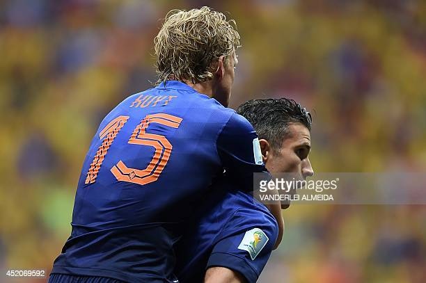 Netherlands' forward and captain Robin van Persie celebrates with Netherlands' midfielder Dirk Kuyt after scoring a goal during the third place...
