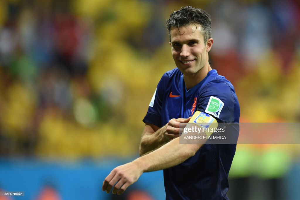 Netherlands' forward and captain Robin van Persie reacts at the end of the third place play-off football match between Brazil and Netherlands during the 2014 FIFA World Cup at the National Stadium in Brasilia on July 12, 2014. Netherlands won 3-0.