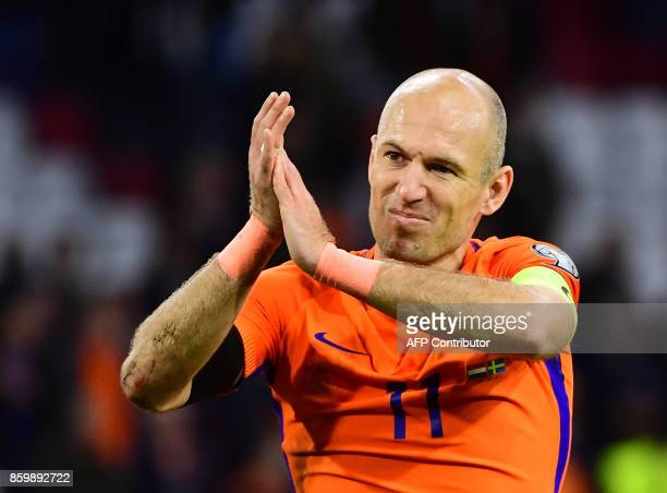 TOPSHOT Netherlands' forward Arjen Robben acknowledges the fans following their FIFA World Cup 2018 football Group A qualification match between the...