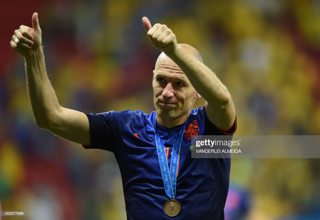 Netherlands' forward Arjen Robben celebrates after receiving a bronze medal at the end of the third place play-off football match between Brazil and Netherlands during the 2014 FIFA World Cup at the National Stadium in Brasilia on July 12, 2014. Netherlands won 3-0.