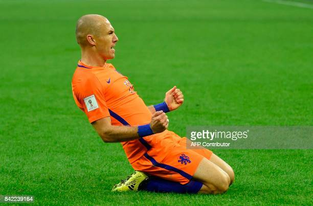 Netherland's forward Arjen Robben celebrates after scoring during the FIFA World Cup 2018 qualification football match between Netherlands and...