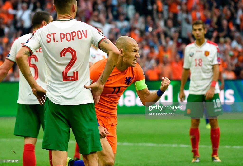 Netherlands forward Arjen Robben celebrates after scoring during the FIFA World Cup 2018 qualification football match between Netherlands and Bulgaria in Amsterdam on September 3 , 2017. /