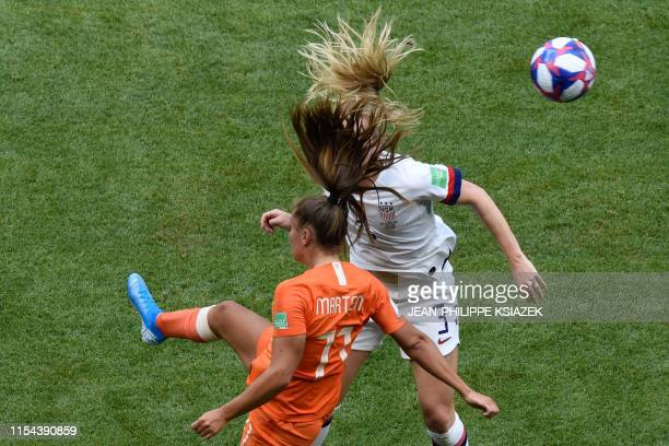 TOPSHOT Netherlands' forward Lieke Martens and United States' midfielder Sam Mewis vie for the ball during the France 2019 Womens World Cup football...