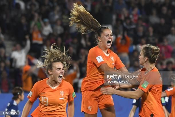 TOPSHOT Netherlands' forward Lieke Martens celebrates after scoring a goal during the France 2019 Women's World Cup round of sixteen football match...