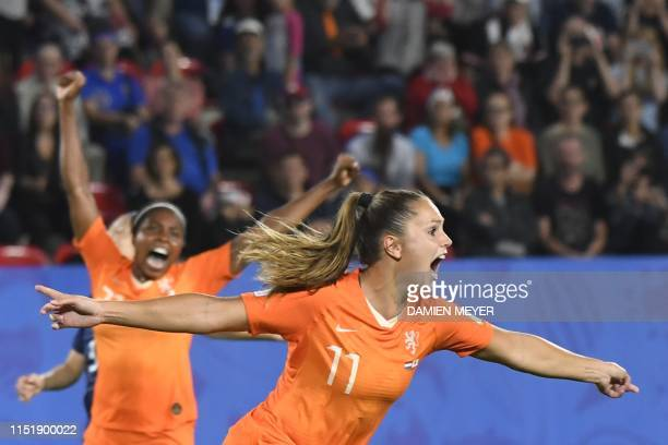 TOPSHOT Netherlands' forward Lieke Martens celebrates after scoring a goal during the France 2019 Women's World Cup round of sixteen football match...