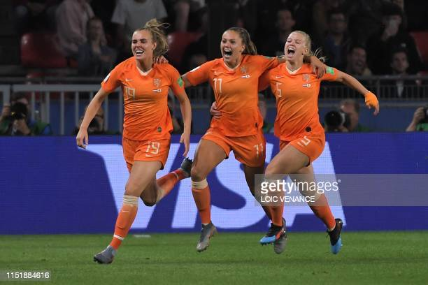 TOPSHOT Netherlands' forward Lieke Martens celebrates with teammates after scoring a goal scores a goal during the France 2019 Women's World Cup...