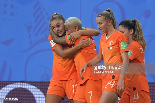 TOPSHOT Netherlands' forward Lieke Martens is congratulated by teammates after scoring a goal during the France 2019 Women's World Cup round of...