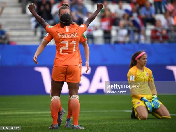 TOPSHOT Netherlands' forward Lineth Beerensteyn celebrates scoring her team's second goal as Canada's goalkeeper Stephanie Labbe reacts during the...