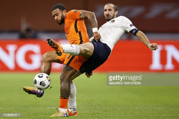 Netherlands' forward Memphis Depay and Italy's defender Giorgio Chiellini fight for the ball during the UEFA Nations League Group A football match...