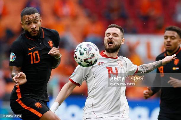 Netherlands' forward Memphis Depay and North Macedonia's defender Darko Velkovski vie for the ball during the UEFA EURO 2020 Group C football match...