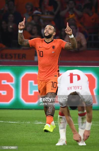 Netherlands' forward Memphis Depay celebrates after scoring a goal during the FIFA World Cup Qatar 2022 qualifying round Group G football match...