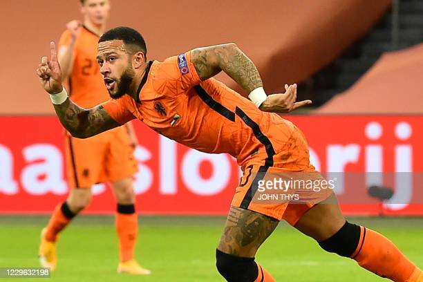 Netherlands' forward Memphis Depay celebrates after scoring his team's third goal during the UEFA Nations League football match between The...