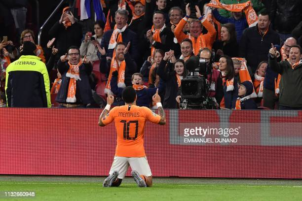 Netherlands' forward Memphis Depay celebrates after scoring the equalizer during the UEFA Euro 2020 Group C qualification football match between The...