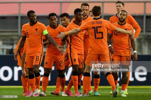 Netherlands' forward Memphis Depay celebrates his goal with teammates during the international friendly football match between Netherlands and...