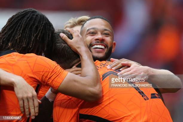 Netherlands' forward Memphis Depay celebrates with teammates the team's second goal during the friendly football match between Netherlands and...