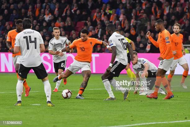 Netherlands' forward Memphis Depay kicks to score the equalizer during the UEFA Euro 2020 Group C qualification football match between The...