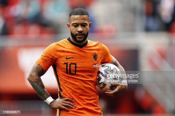 Netherlands' forward Memphis Depay reacts during the friendly football match between Netherlands and Georgia at De Grolsch Veste Stadium in Enschede...