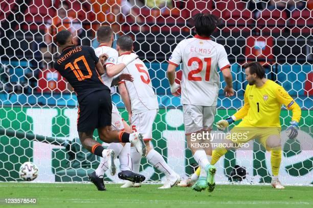 Netherlands' forward Memphis Depay scores his team's opening goal with Netherlands' defender Matthijs de Ligt during the UEFA EURO 2020 Group C...