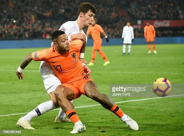 Netherlands' forward Memphis Depay vies for the ball with France's defender Benjamin Pavard during the UEFA Nations League football match between the...