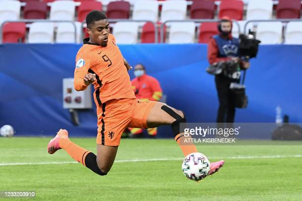 Netherlands' forward Myron Boadu kicks the ball to score the 2-1 goal during extra time during the UEFA Under21 Championship quarter-final football...