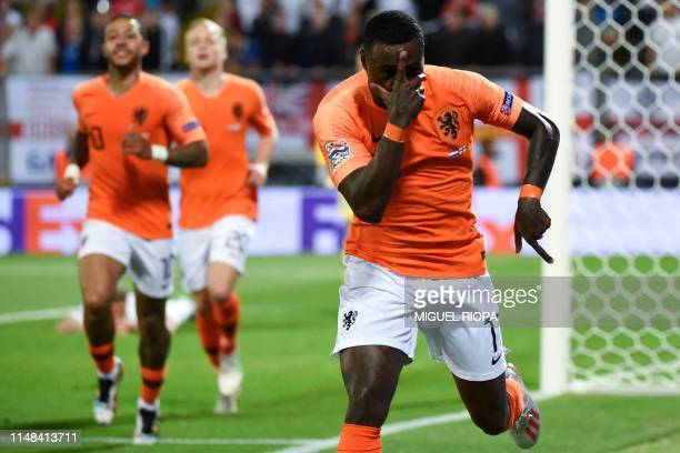 TOPSHOT Netherlands' forward Quincy Promes celebrates his team's second goal during the UEFA Nations League semifinal football match between The...