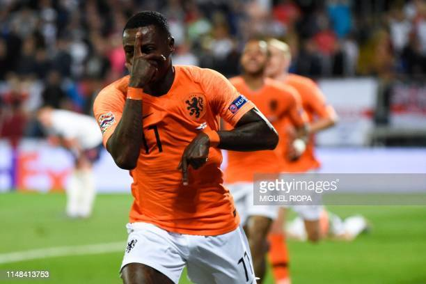Netherlands' forward Quincy Promes celebrates his team's second goal during the UEFA Nations League semifinal football match between The Netherlands...