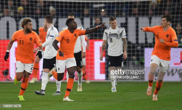 Netherlands' forward Quincy Promes celebrates scoring the 21 goal with his teammates during the UEFA Nations League football match Germany v the...