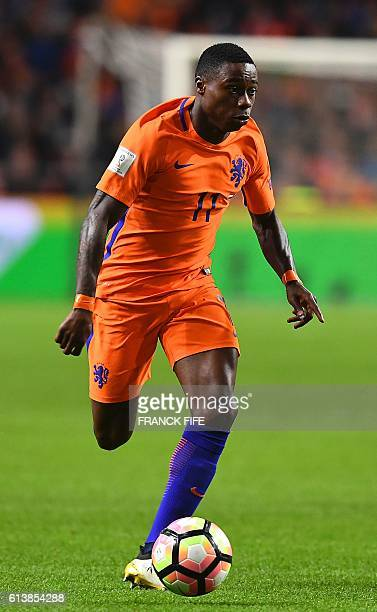 Netherlands' forward Quincy Promes runs with the ball during the FIFA World Cup 2018 qualifying football match Netherlands vs France on October 10,...