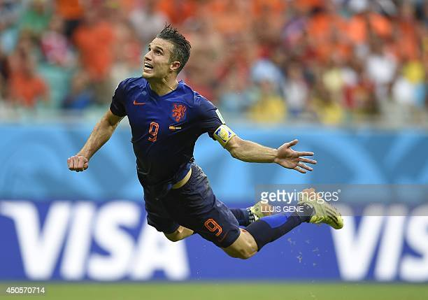 Netherlands' forward Robin van Persie scores during a Group B football match between Spain and the Netherlands at the Fonte Nova Arena in Salvador...
