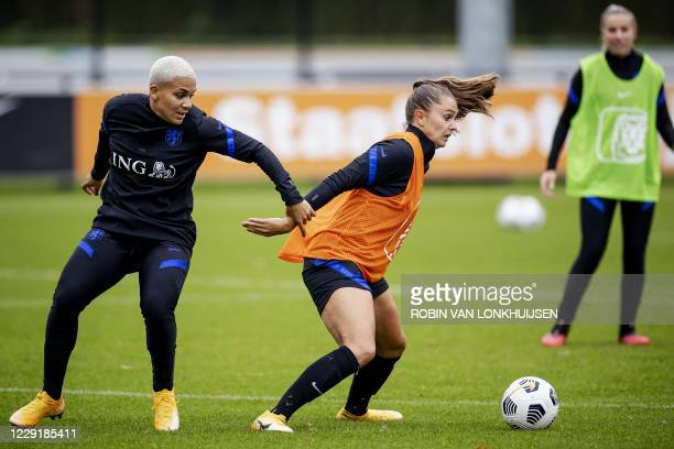 Netherlands' forward Shanice van de Sanden and Netherlands' forward Lieke Martens take part in a training session at the KNVB Campus in Zeist, on...