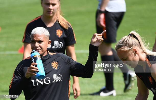 Netherlands' forward Shanice Van De Sanden speaks with a teammate during a training session in Oullins near Lyon on July 2 during the France 2019...