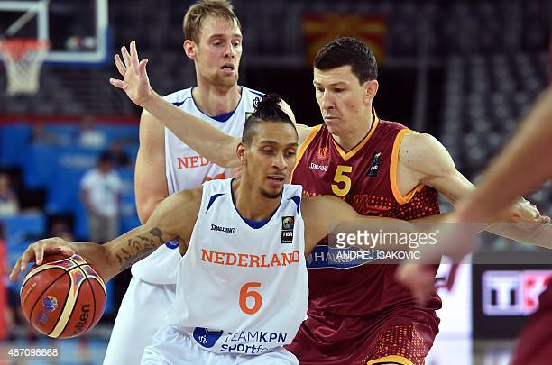 Netherlands' forward Worthy De Jong dribbles next to Macedonia's guard Vlado Ilievski during the Group C qualification basketball match between...