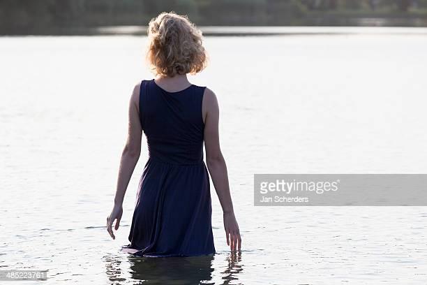 Netherlands, Gelderland, De Rijkerswoerdse Plassen, Beautiful woman standing in lake