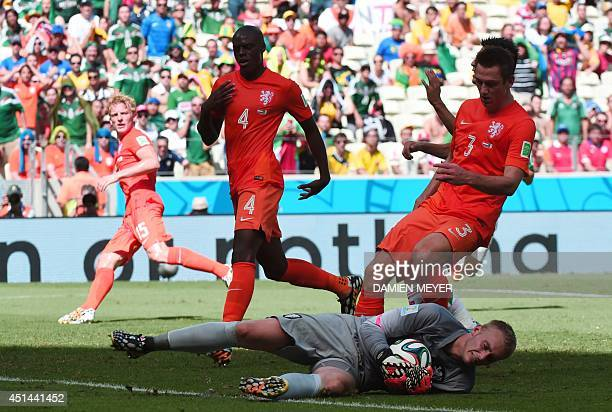 Netherlands' goalkeeper Jasper Cillessen saves a ball during a Round of 16 football match between Netherlands and Mexico at Castelao Stadium in...