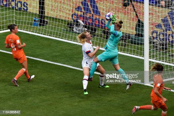 TOPSHOT Netherlands' goalkeeper Sari van Veenendaal gets to the ball before United States' midfielder Sam Mewis the ball during the France 2019...