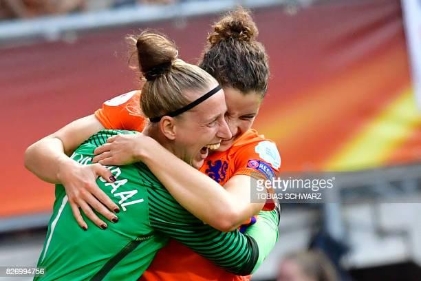 Netherlands' goalkeeper Sari van Veenendaal hugs Netherlands' defender Dominique Janssen as they celebrate after winning the UEFA Womens Euro 2017...
