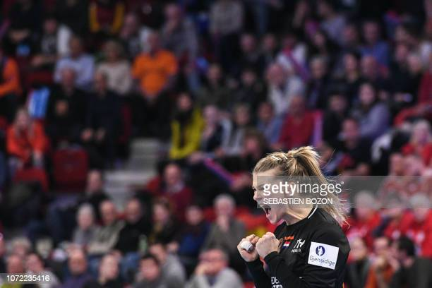 Netherlands' goalkeeper Tess Wester jubilates during the 2018 European Women's handball Championships Group 2 main round match between Netherlands...